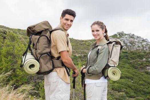 Couple standing on mountain terrain