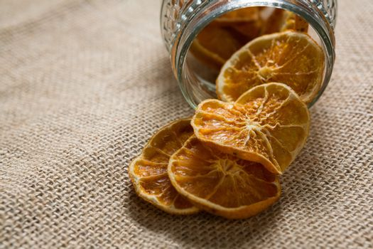 Dried lemons spilling out of jar