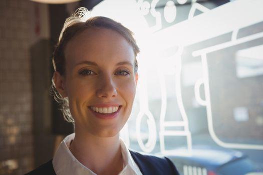 Portrait of owner in cafe