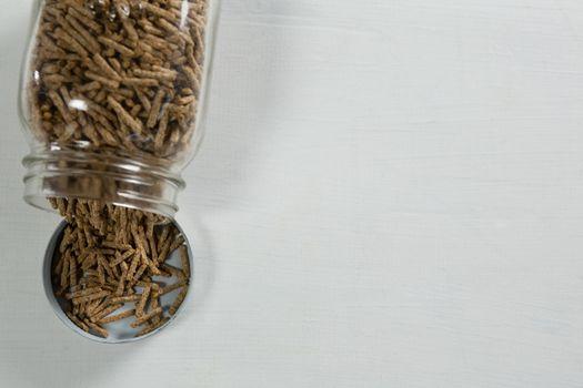 Cereal bran sticks spilling from glass jar