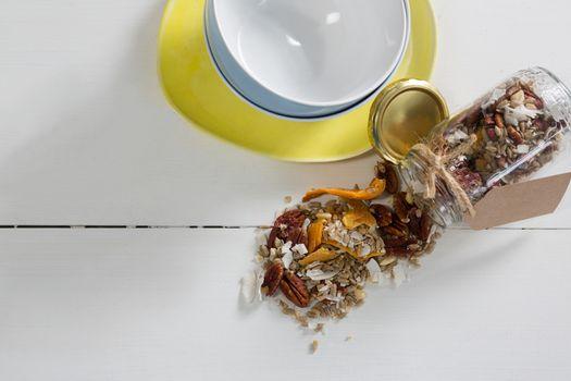 Breakfast cereals spilling from jar