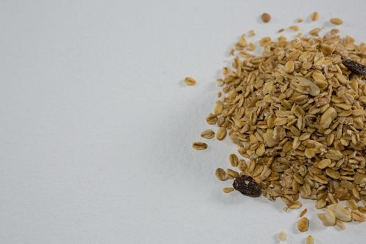 Crunchy granola scattered on white background