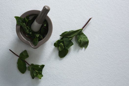 Holy basil in mortar pestle