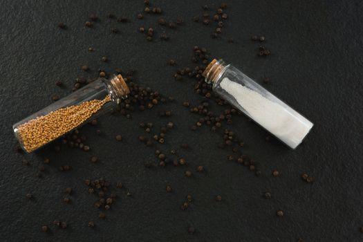 Salt and pepper shaker on black background