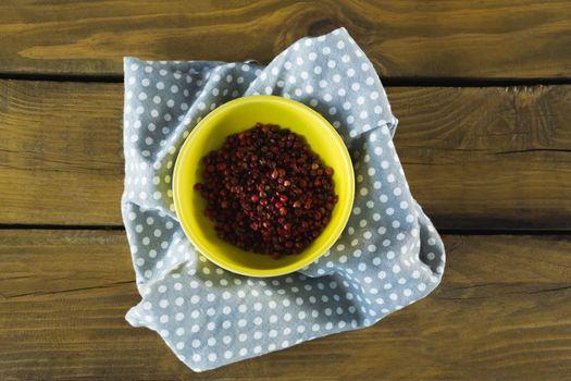 Pink peppercorn in bowl