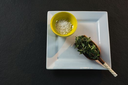 Herb in a scoop with salt