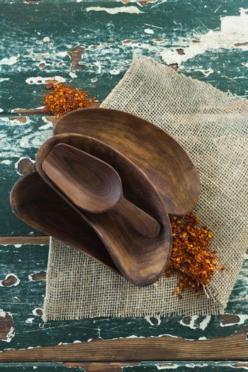 Various wooden scoop on table