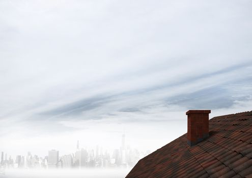 Roof with chimney and foggy sky