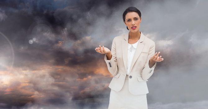 Businesswoman in front of twilight sky