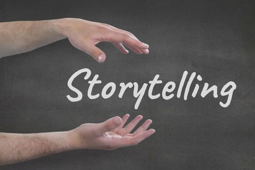 Hands interacting with storytelling business text against grey background