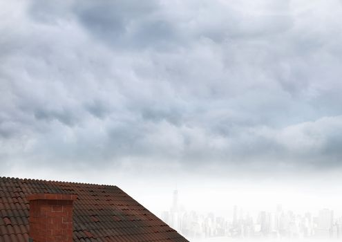 Roof with chimney and cloudy city