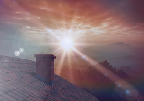 Roof with chimney and twilight sunset in landscape