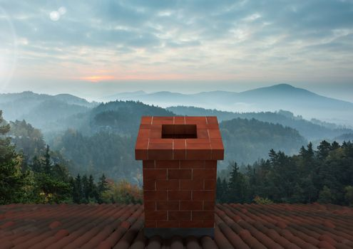 Roof with chimney and misty landscape