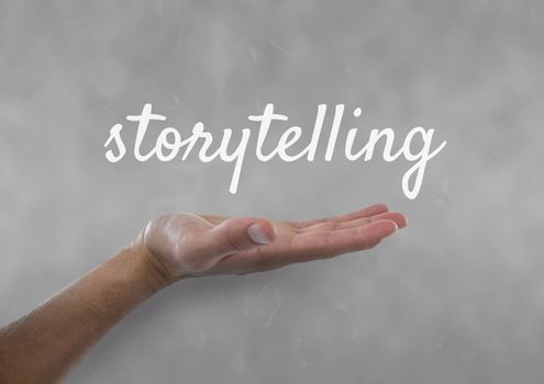 Hand interacting with storytelling business text against grey background