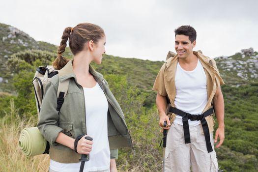 Couple walking on mountain terrain