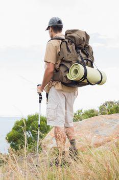Hiking man walking on mountain terrain