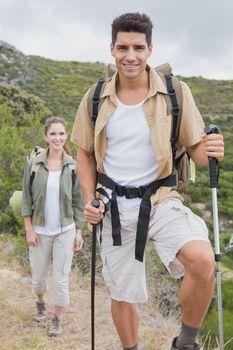 Hiking couple walking on mountain terrain