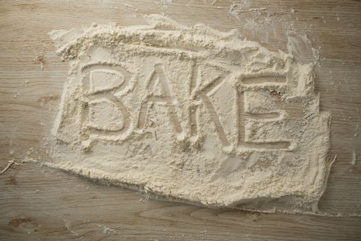 Overhead view of bake text on flour