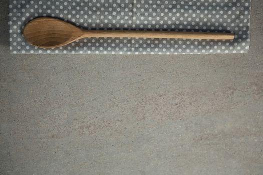 Wooden spoon on napkin