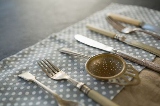 Close up of cutlery on napkin