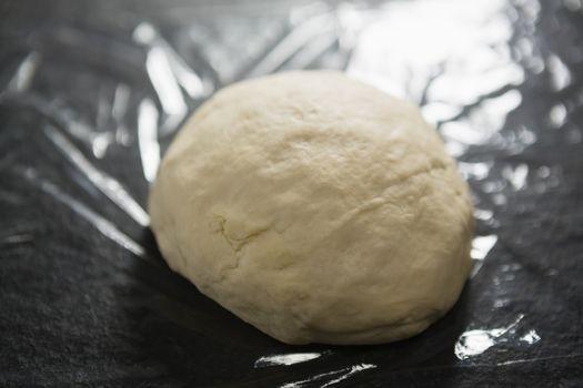 Unbaked dough on plastic wrap