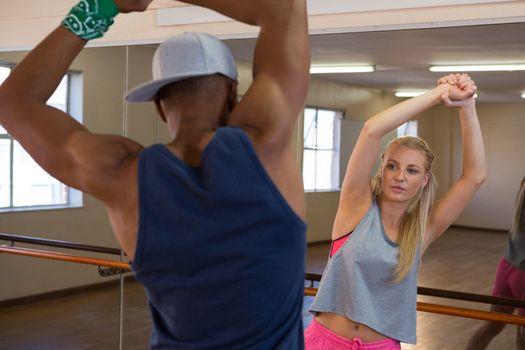 Dancers warming up in studio