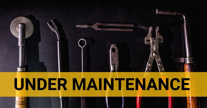Under maintenance text against tools photo
