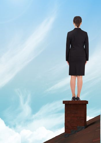 Businesswoman on roof chimney with sky