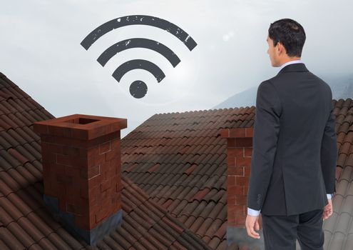 Wi-fi icon and Businessman standing on Roofs with chimney and fog