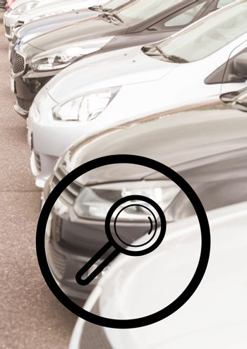 Magnifying glass against cars