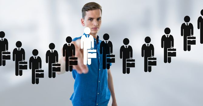 Digital composite of Businessman interacting and choosing a person from group of people icons