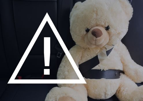 Caution sign icon against teddy bear in the car