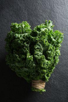 Fresh kale bundle on slate