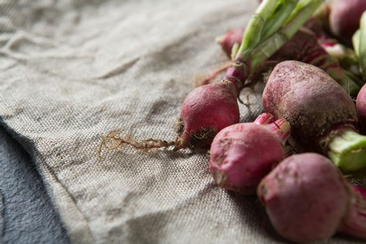 Close-up of red radishes on burlap