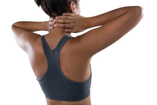 Female athlete massaging neck