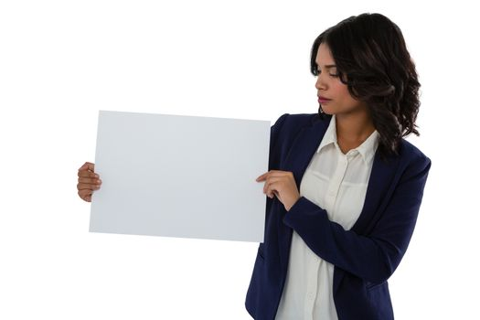 Businesswoman looking at placard
