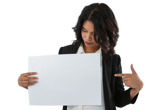 Businesswoman pointing at placard