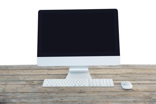 Desktop computer on wooden table