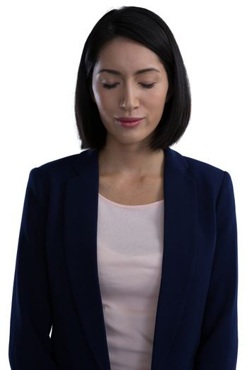 Businesswoman standing with her eyes closed