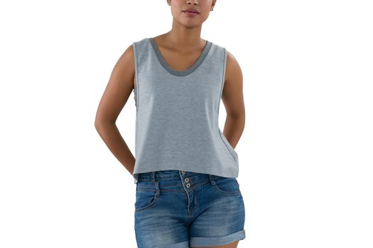 Mid section of young woman in casual clothing