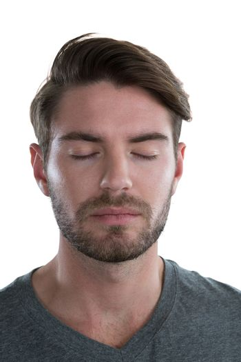 Man standing with eyes closed