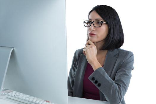 Businesswoman working on desktop pc