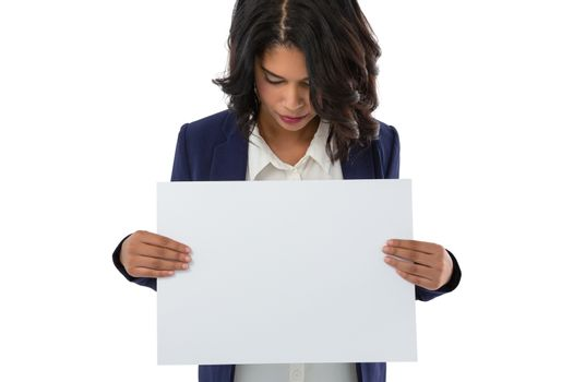 Young businesswoman holding placard