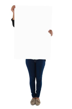 Businesswoman holding blank placard