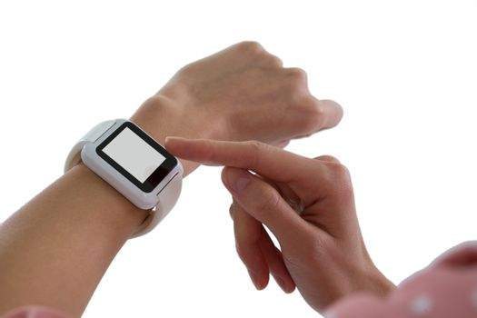 Womans hand using smartwatch