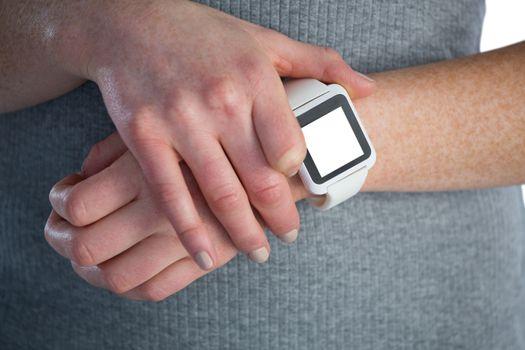 Businesswoman adjusting smart watch
