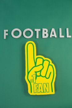 Foam hand on green background