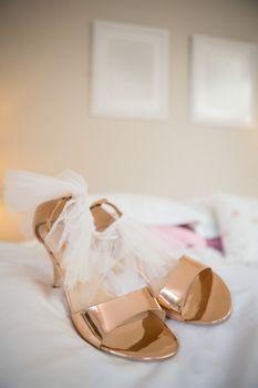 Bride sandals on bed