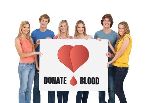 Students holding a sign with donate blood text