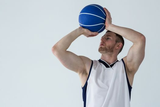 Determined player holding basketball